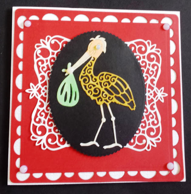 New baby card - stork with baby bundle