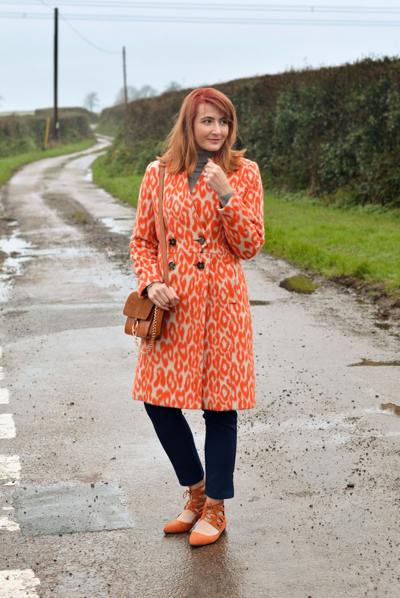 Orange animal print coat, grey roll neck | Not Dressed As Lamb