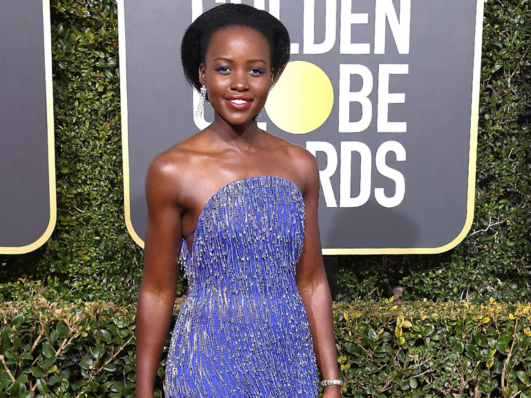 Lupita Nyong'o in blue Calvin Klein Dress