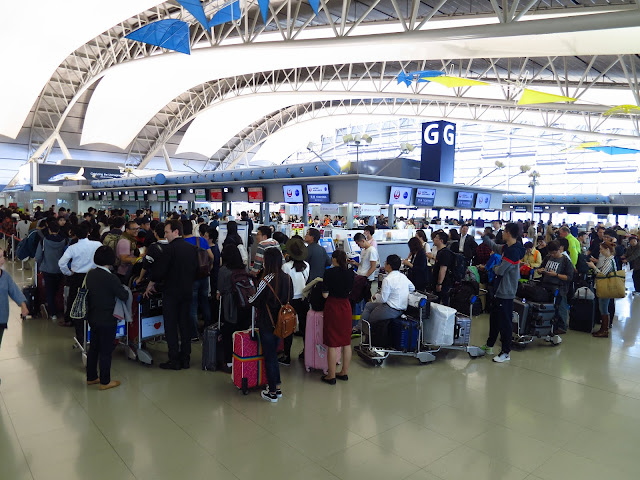 Crowd at Osaka Kansai KIX International Airport. Tokyo Consult. TokyoConsult.
