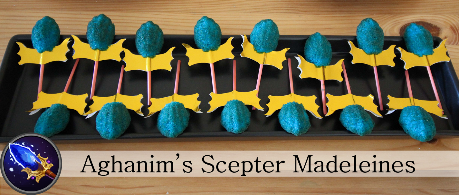 Blue lemon madeleines on decorated kabob sticks look like dota 2 aghanim's scepters.