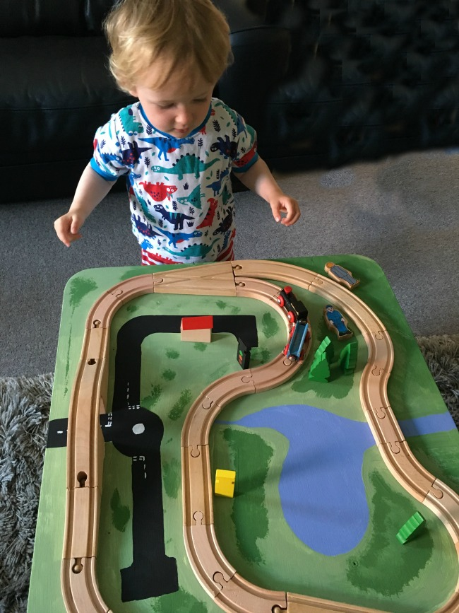 simple-DIY-wooden-train-track-table-and-toddler-playing