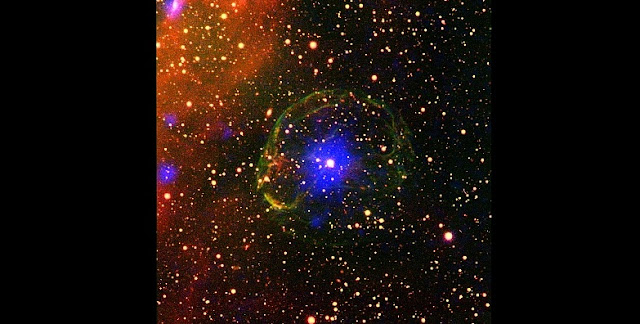 Composite image of the X-ray pulsar SXP 1062 surrounded by the supernova remnant. The false-colour image combines X-ray (blue) and optical data (oxygen: green, hydrogen: red). Credit: ESA / XMM-Newton / L. Oskinova, University of Potsdam, Germany / M. Guerrero, Instituto de Astrofisica de Andalucia, Spain (X-ray); Cerro Tololo Inter-American Observatory / R. Gruendl & Y. H. Chu, University of Illinois at Urbana-Champaign, USA (optical).