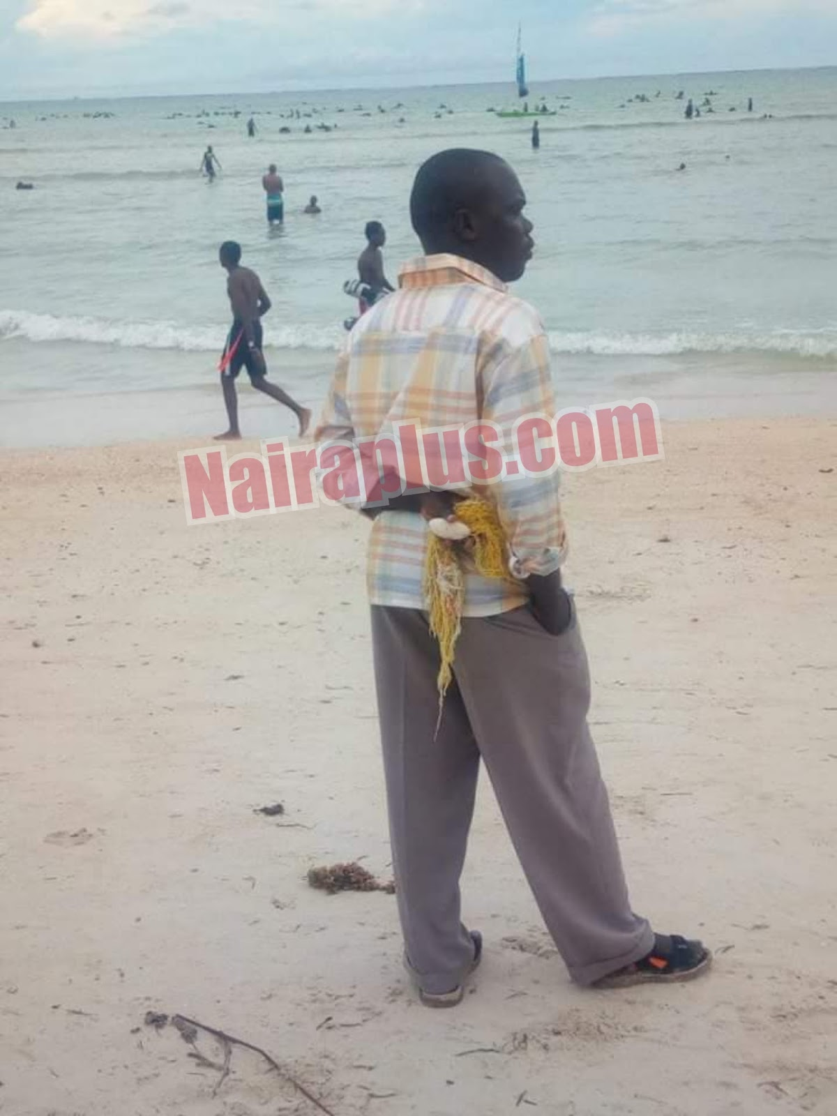 African Man Spotted With A Sponge And Soap, Getting Ready To Bath At The Beach.