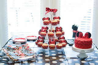 Rosette Minnie Mouse Smash Cake with matching cupcakes and cookies for a one-year-old birthday party.