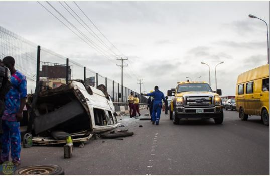 Tension As Commercial Bus Somersaults on Third Mainland Bridge, Lagos (Photos)