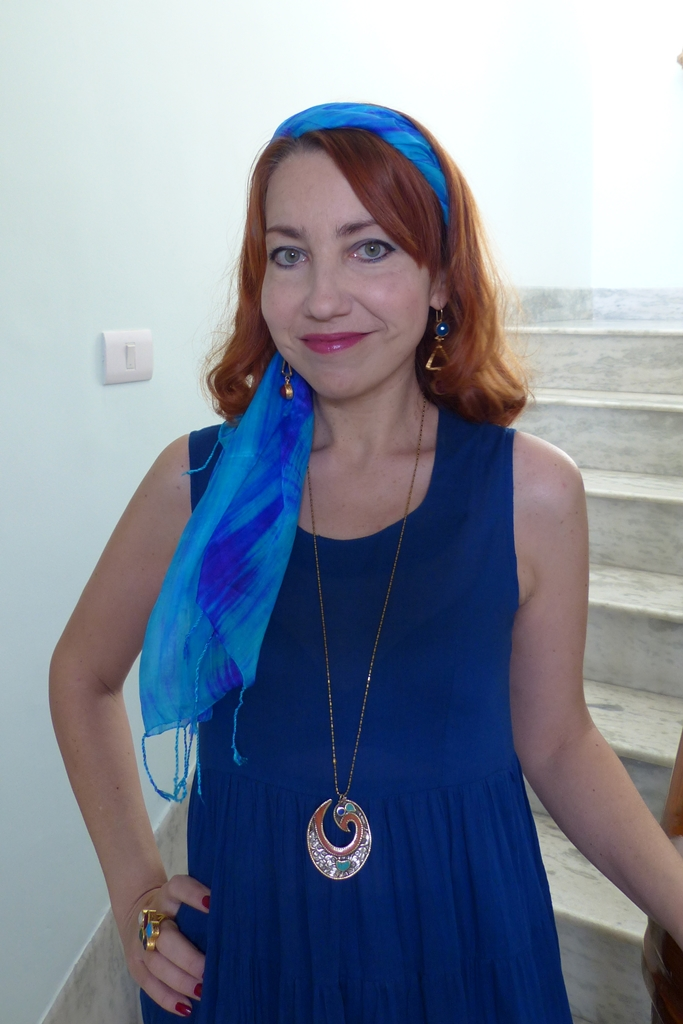 Navy blue dress, multi stone jewelry and silk headscarf