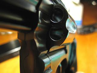 A closeup image of a handgun.