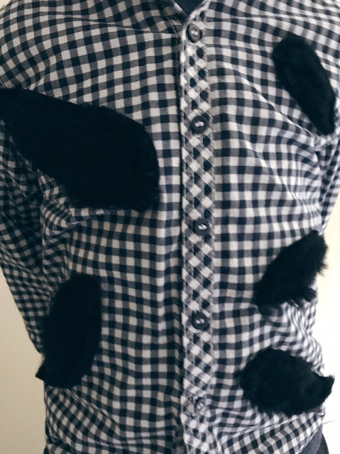 Shirt with fur sewn on to look like it's bursting through