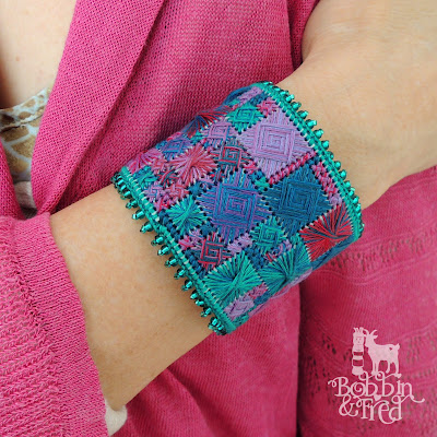 Norwich stitch embroidered cuff bracelet in purple, blue, pink and green