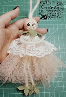 come decorare i visi delle bambole