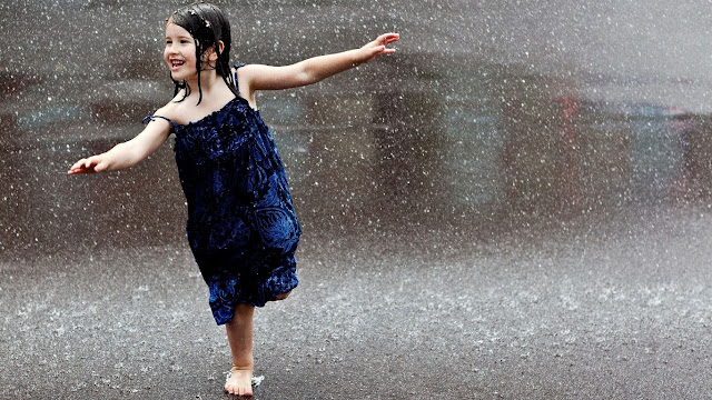 Girl Enjoying in Rain