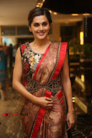 Tapsee Pannu Latest Stills in Red Silk Saree at Anando hma Pre Release Event .COM 0051.JPG