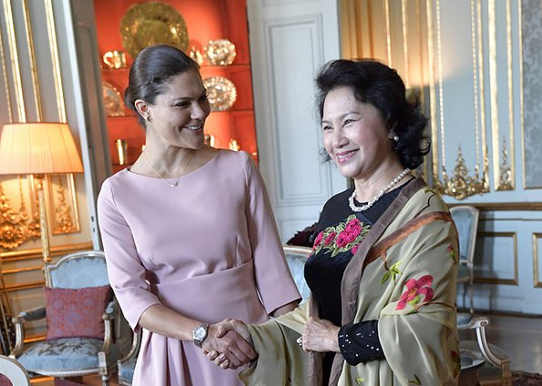 The fold London Camelot dress. Crown Princess Victoria of Sweden met with the Chairwoman of Vietnam's National Assembly Nguyen Thi Kim Ngan at the Royal Palace.