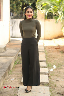 Tollywood Actress Punarnavi Bhupalam Latest Po Gallery in Black Trouser Pant at Pittagoda Movie Interview  0157.JPG