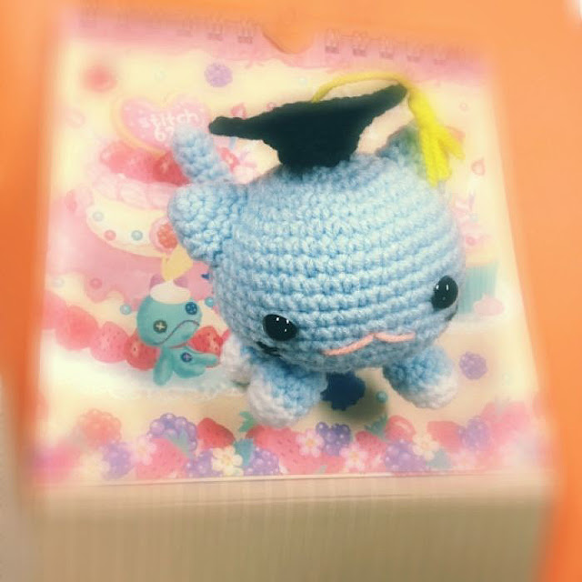 crocheted roly poly cat with graduation hat amigurumi