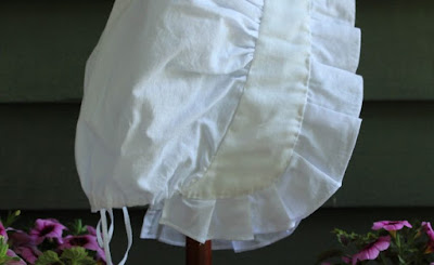 18th century style women's cap made of white linen with pleated front