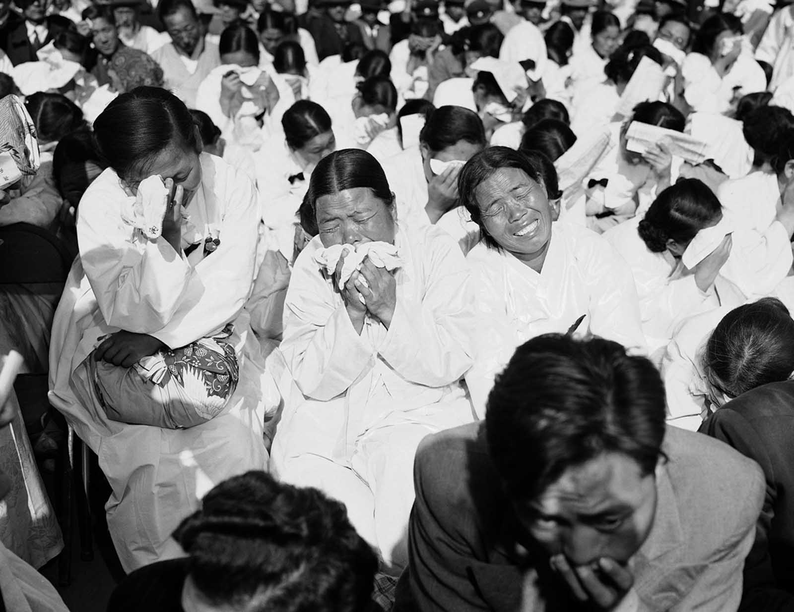 South Korean women weep as they listen to President Syngman Rhee speak at a memorial service in Seoul, October 17, 1953. The service honored the 33,964 South Koreans killed in the last year of the war.