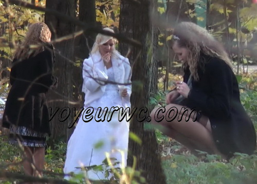 A bride in her wedding dress pissing outdoors with a spy cam observing (Wedding Pissing Park 01)