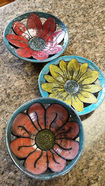 Beautiful raku fired floral pottery plates and bowls by Lily L.