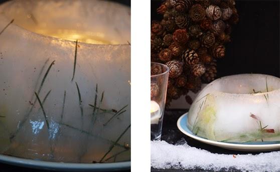 Runde islygter med juleroser og fyrrenåle