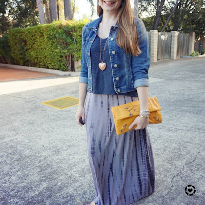 awayfromtheblue instagram layering maxi dress with a tee and denim jacket, yellow Balenciaga clutch