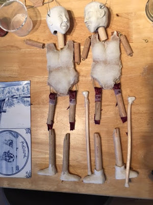two puppets / marionettes in the making. Showing wooden bodies and sculpted heads  By Corina Duyn