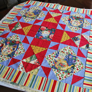Jane's table topper: QuiltBee