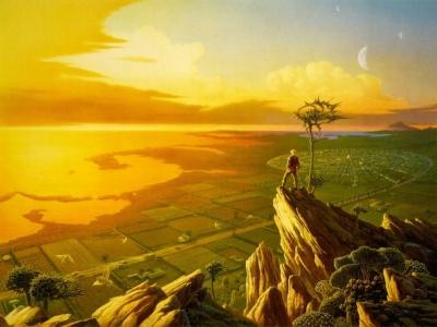 Imagen en el que un chico está subido a unas rocas y puede contemplar diferentes paisajes desde ellas, un mar en tono naranja por el atardecer y verdes campos de cultivo.