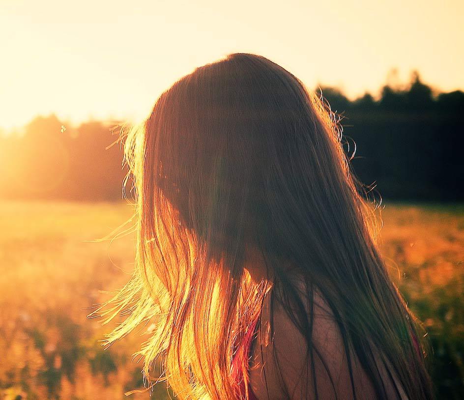 girl hiding face behind hairs dp