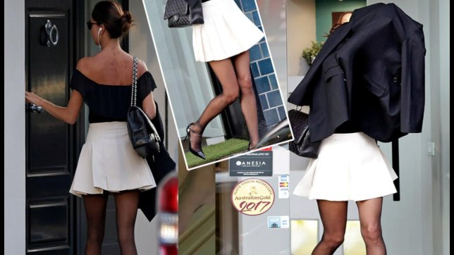 more photos 43efd d7db5 Shopping.com: Belen sfila con i tacchi a spillo, ma in volto ...