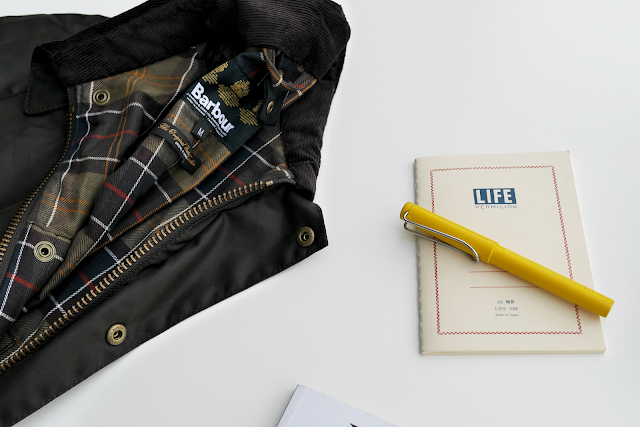 Barbour wax jacket and notebook