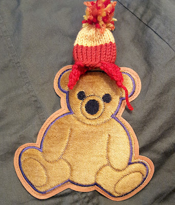 Kaylee Frye bear patch wearing a Jayne Hat pin from PDX Browncoats