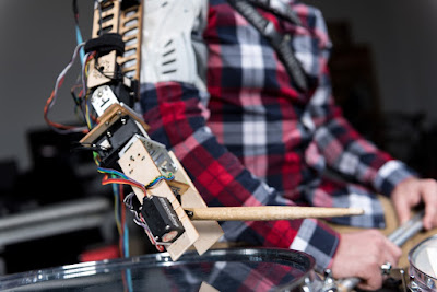 https://www.washingtonpost.com/news/innovations/wp/2016/02/18/scientists-created-a-three-armed-cyborg-to-play-the-drums-like-no-human-can/