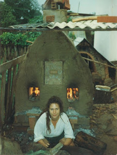 Jera in Bolivia sitting in front of a handmade kiln