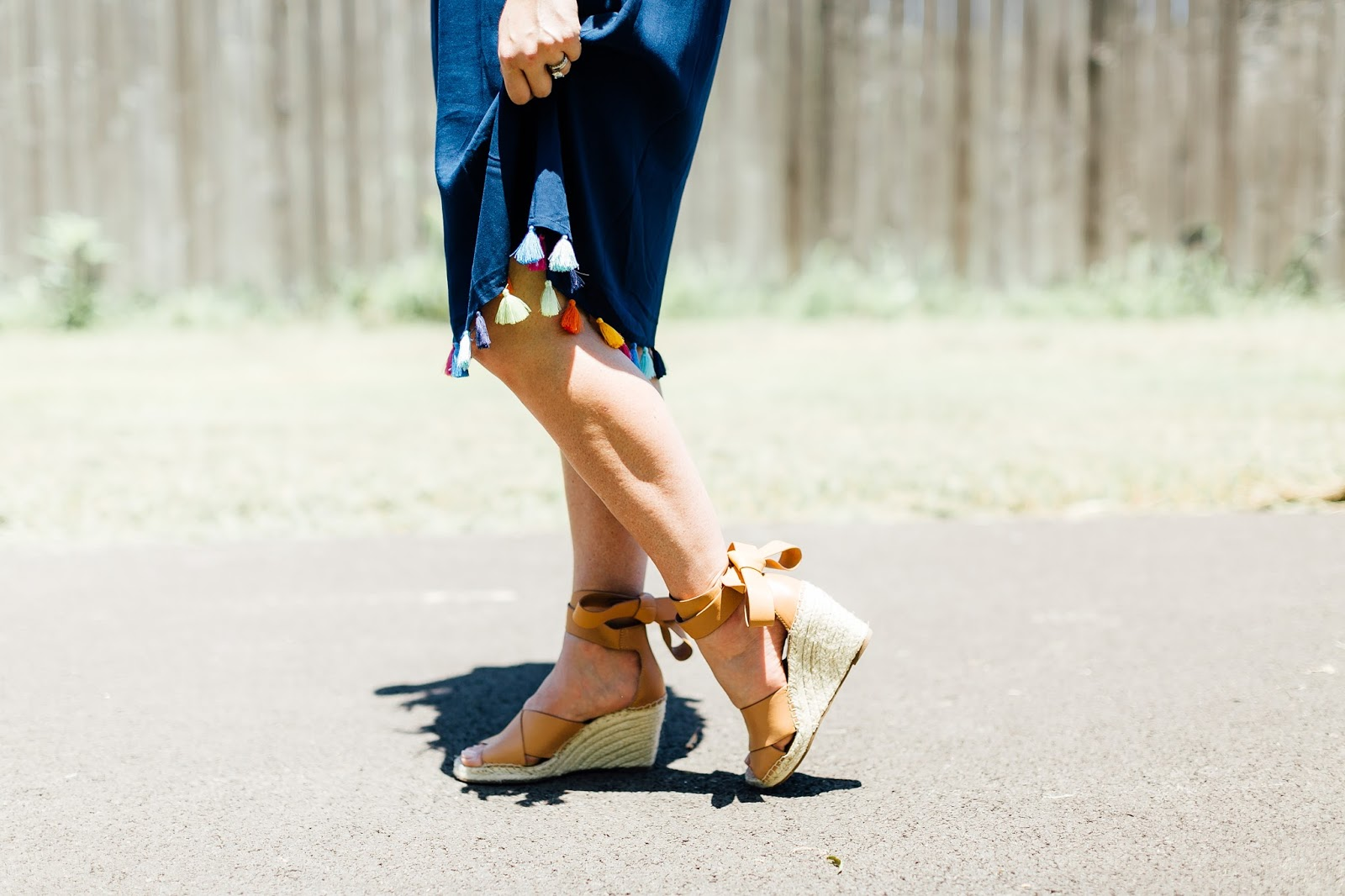 Trend Spin Linkup - Poms & Tassels trend by fashion blogger Laura of Walking in Memphis in High Heels