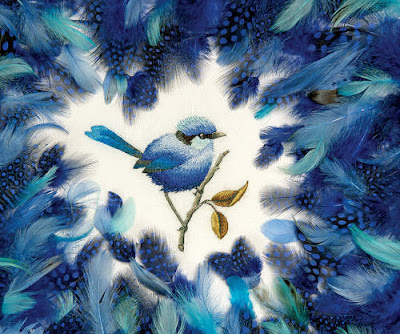 Project photo of Royal Blue project from Inspirations issue #77. (Blue thread painted bird surrounded by assorted blue feathers.)