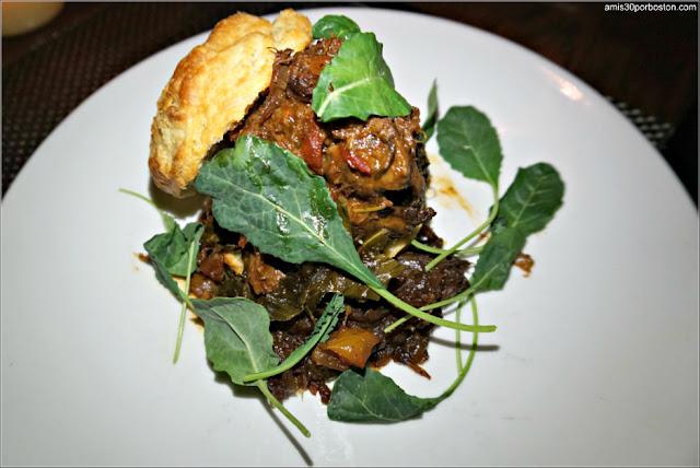 Slowly Braised Beef Cheek: Buttermilk biscuit, caramelized onion jam, collard greens
