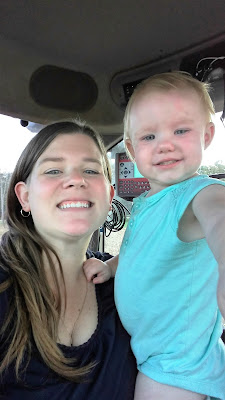 Having fun in the tractor with Mom