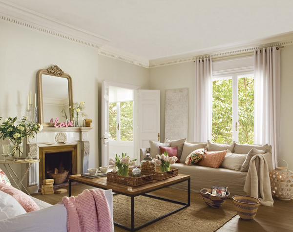 neutral living room with pink accents
