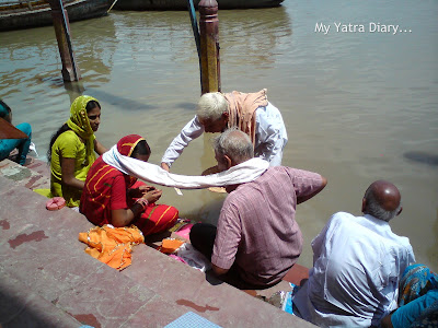 A prayer ceremony being conducted at the Yamuna River Ghat, Mathura