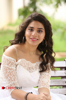 Actress Tejaswini Pictures in White Dress at Lachhi Teaser Launch  0101.JPG