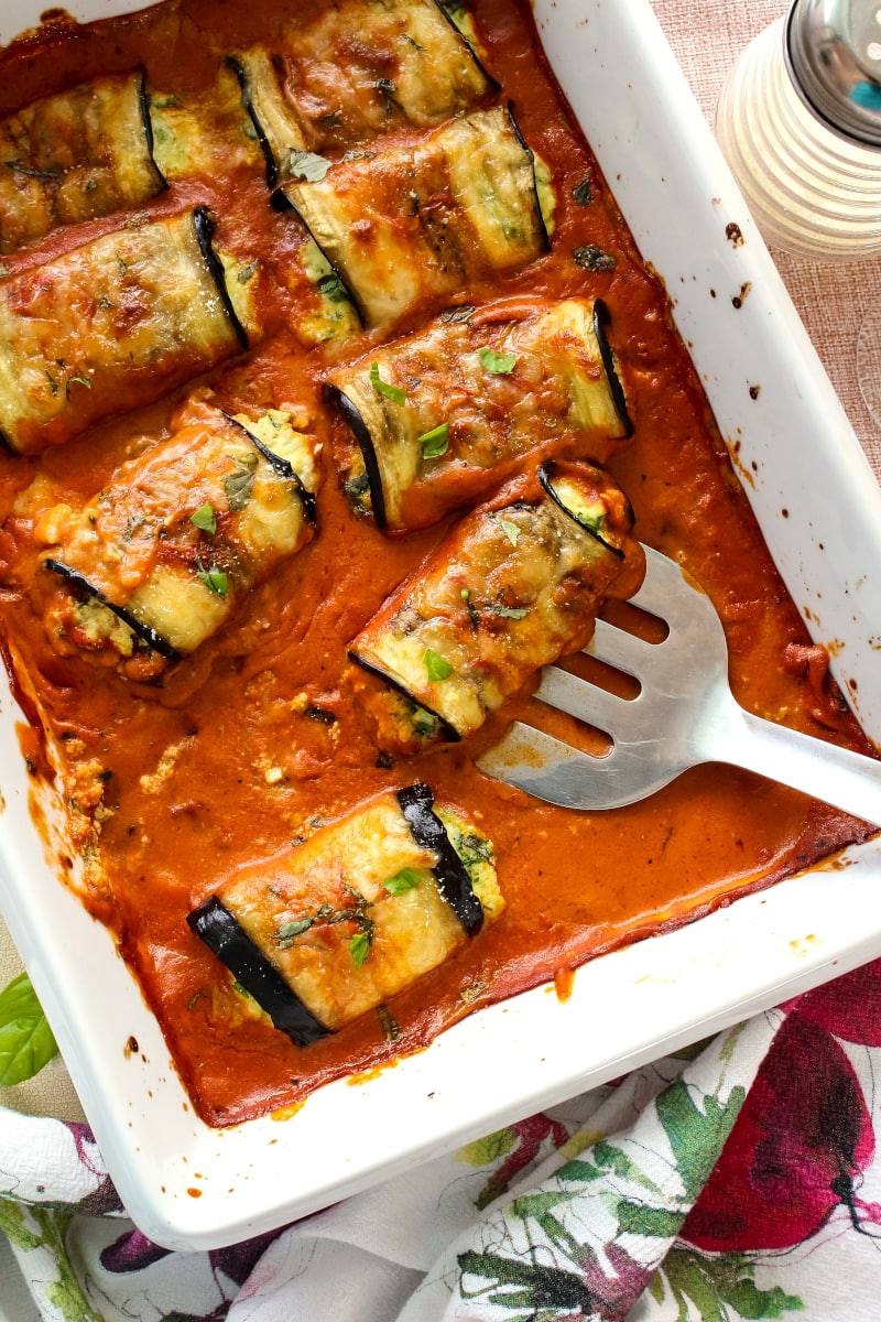 Eggplant Rollatini Rosa is a meatless dinner that features cheese and spinach stuffed eggplant baked in a creamy mixed Rosa Sauce. It is the perfect dinner recipe for your next special occasion! #eggplant #dinnerrecipe @Bertolli #sponsored