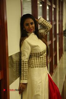Telugu Actress Sri Reddy Mallidi Stills in White Beautiful Dress at Marriage Needs Bridal Fashion Week 2017 Logo Launch  0024.JPG