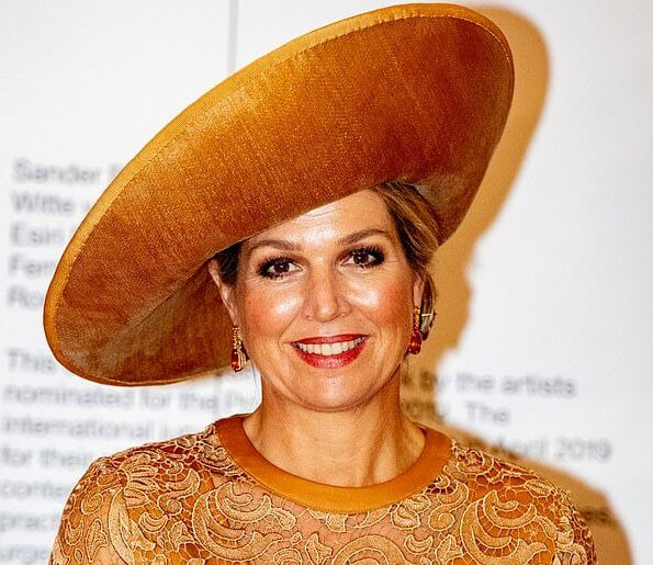 Queen Maxima wore Claes Iversen lace midi dress. Minister Ingrid van Engelshoven presented the award to Rory Pilgrim
