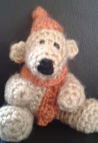 http://www.ravelry.com/patterns/library/free-pattern---teddy-bear-with-a-bobble-hat-and-scarf