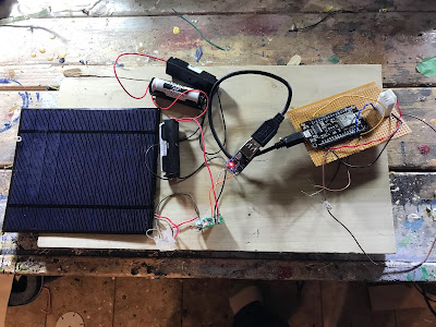 NodeMCU weather station hooked up to a solar charger circuit
