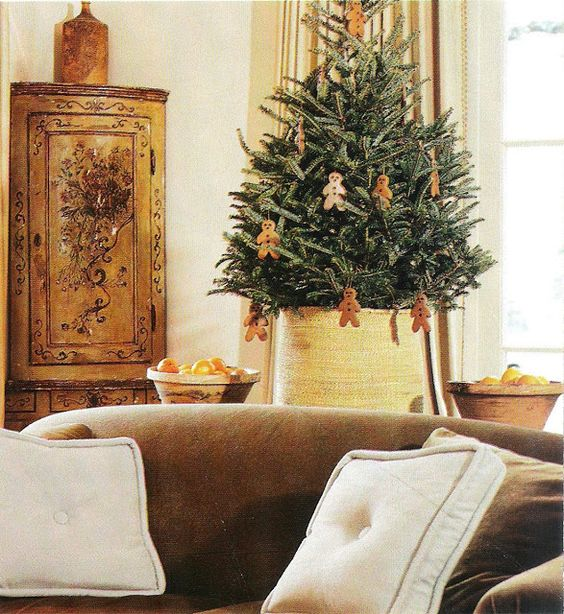 Pamela Pierce designed living room with live tree decorated with gingerbread cookies for Christmas.