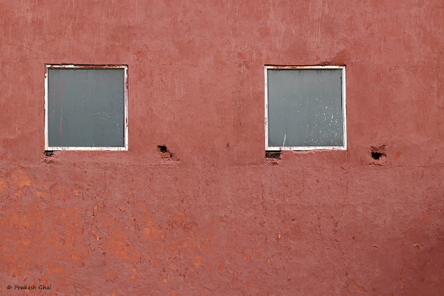 A Blog post on a Minimal Art Photograph of Two Squares on a Red Wall.
