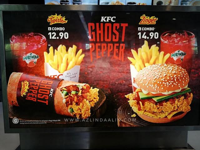 PEDAS SANGAT KE KFC GHOST PEPPER? - KFC sekarang ni, rajin keluarkan menu baru kan. As usual, kalau ada menu baru je di KFC..mummy akan terjah jugak lah. Nak jugaklah merasa kan menu baru. Biasanya menu baru ini limited time je ! Berbalik kisah menu baru di KFC iaitu KFC GHOST PEPPER. Bila nampak KFC GHOST PEPPER ni, pada awalnya rasa serba salah sangat-sangat nak cuba. Takut pedas tak ingat je. Mummy memang jenis tahan pedas, setakat cili api buat ulam tu.. apa lah sangat kan hehehe.    PEDAS SANGAT KE KFC GHOST PEPPER?     PEDAS SANGAT KE KFC GHOST PEPPER? Mummy risau pedas dia melampau tahap maksimum. Ye lah kan, kang kalau pedas sangat macam samyang tu kang membazir pulak. Hat tu, memang tak boleh nak tahan !  Kami laki bini memberanikan diri untuk mencuba KFC GHOST PEPPER? Jeng jeng jengggggg . Mummy memilih KFC GHOST PEPPER TWISTER manakala, daddy pulak memilih ZInger !    Bungkusan luar KFC GHOST PEPPER. Sama macam wrap biasa KFC Twister, corak je lain !     Gerun tak nampak wrap warna pink merah tu ha? Hehehe memula gerun jugak, ingatkan kulit wrap tu pedas jugak ! Rupanya warna je merah pink, jangan risau kulit tu ha tak pedas tau !     Pedas ke KFC GHOST PEPPER hehehe. Eh isi Twister dalamnya tak sama dalam gambar, isi nya tak sampai atas pun hehehe.      Walau nampak macam tak sampai atas isinya, tapi isi dalamnya padat. Ada isi ayam (spicy), sayuran dan sos smokey BBQ (lebih kurang) sos inilah macam pedas. Tapi, bukan pedas berapi sangat pun. Masih okaylah pedasnya. Boleh tahan lagi.  HARGA KFC GHOST PEPPER? Harga untuk KFC GHOST PEPPER ialah RM12.90 untuk twister . Manakala KFC GHOST PEPPER Zinger pula RM14.90.  Jom cuba KFC GHOST PEPPER , sebab ianya limited time je tau !